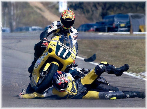 motor bike or motorcycle runs over man in a race