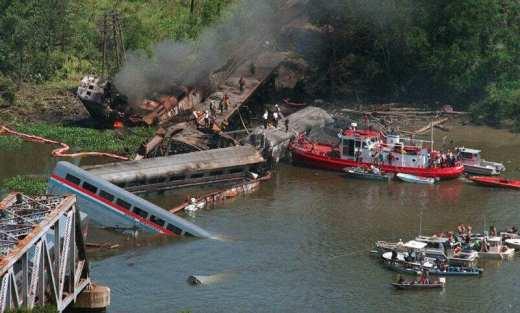 train falls off bridge